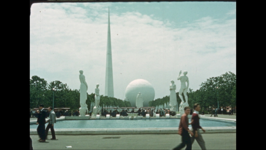 1930s: UNITED STATES: water feature and statues at World Fair 1939. People at World Fair in New York. White sculpture by water.