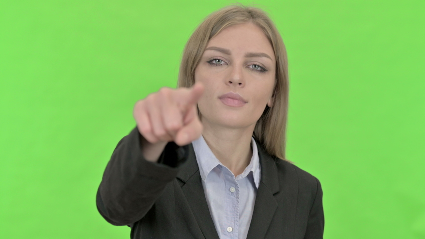Cheerful Young Businesswoman Pointing Finger against Chroma Key | Shutterstock HD Video #1036207241