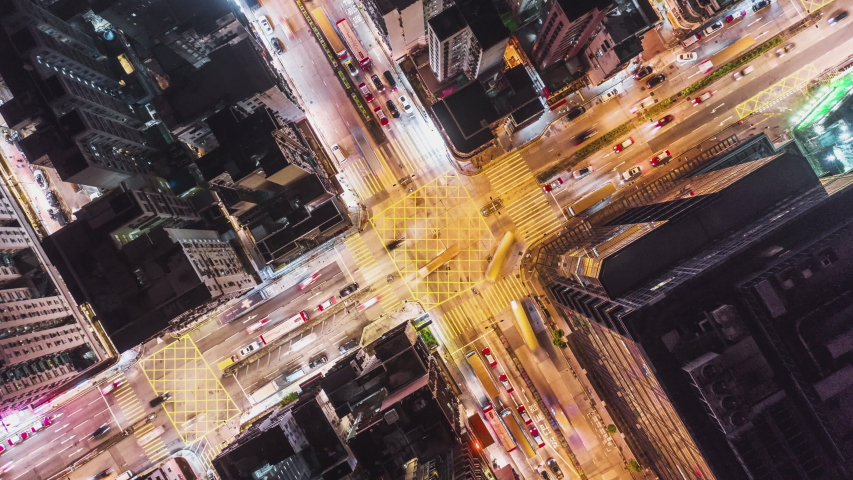 4K UHD Hyperlapse time-lapse of car traffic and people crossing road at night in Hong Kong city downtown. Drone aerial top view, fly upward. Commuter, Asia city life or public transportation concept | Shutterstock HD Video #1036253171