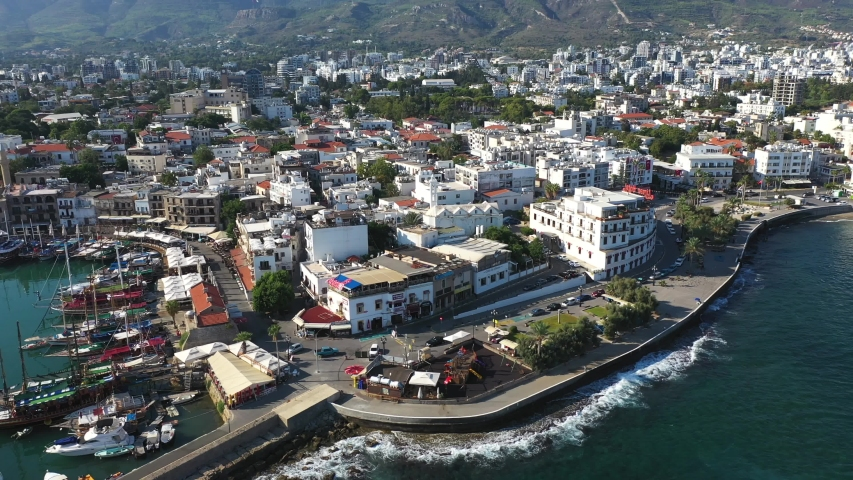 Kyrenia (Girne) is a city on the north coast of Cyprus, known for its cobblestoned old town and horseshoe-shaped harbor. | Shutterstock HD Video #1036395371