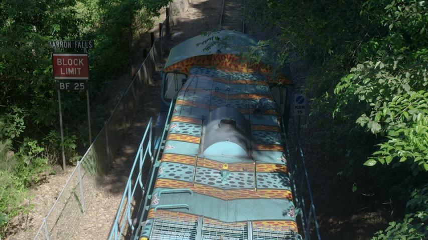 Slow motion, Red Camera: Kuranda rail train leaves a station in Barron Gorge near Cairns. Northern Queensland. Australia. | Shutterstock HD Video #1036416431