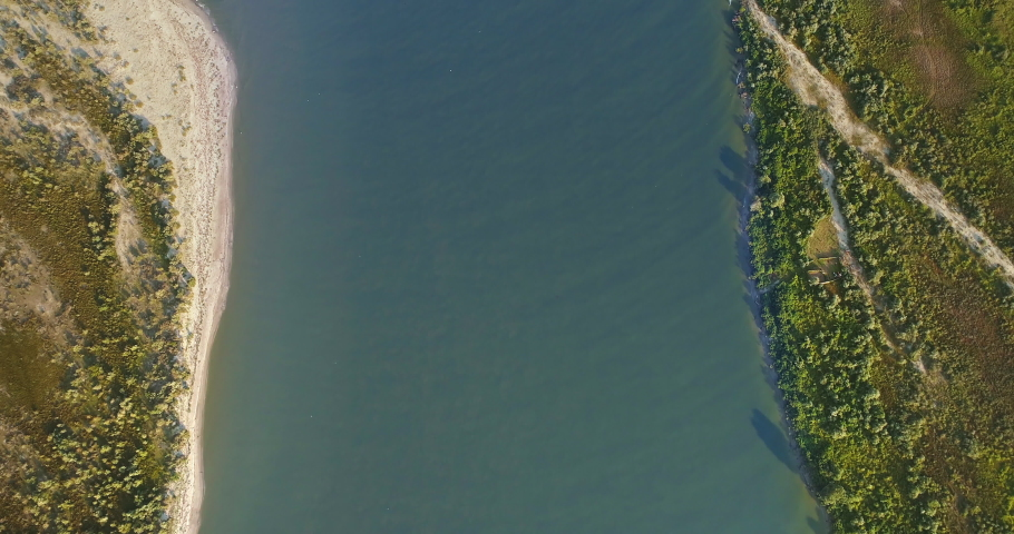 Aerial View of Danube River Mouth Flowing into the Black Sea, Sfantu Gheorghe, Romania, sunny summer day  | Shutterstock HD Video #1036449491