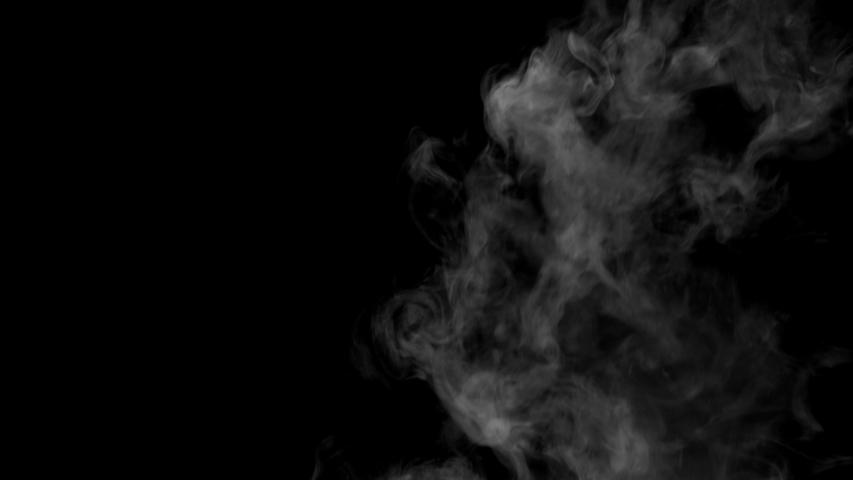 The smoke motion isolated on black background ,slow motion movement #1036711451