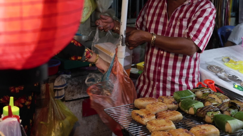 Vietnam Phu Quoc island 1 April 2019. night market in Vietnam on the island. Vietnamese food vendor sells at the night market #1036809281