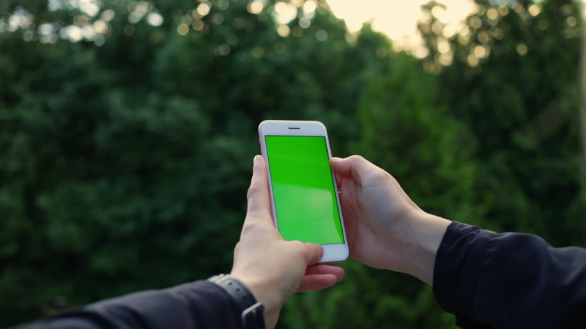 Close up woman hands use smartphone on nature green screen chroma scroll social media shopping 5 | Shutterstock HD Video #1036896341