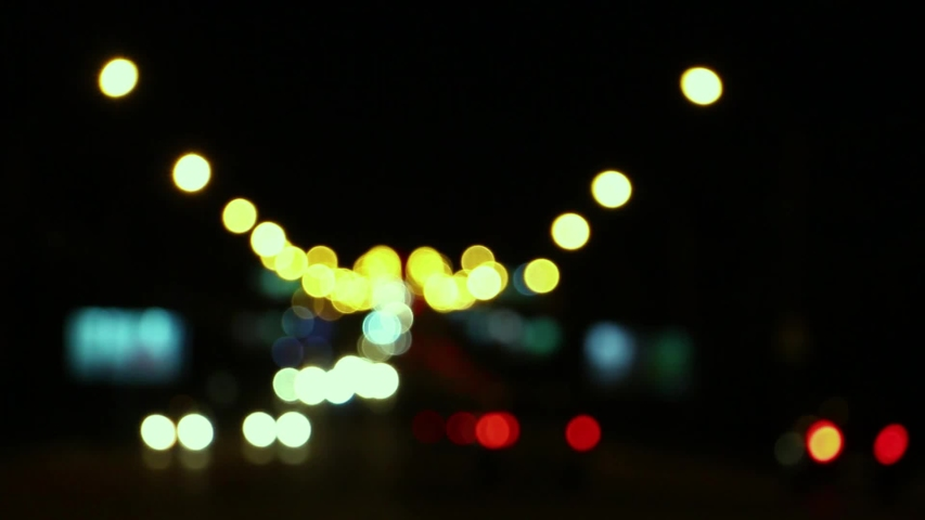 Blurred car lights at the crossroads of the big night city   Shutterstock HD Video #1036901201