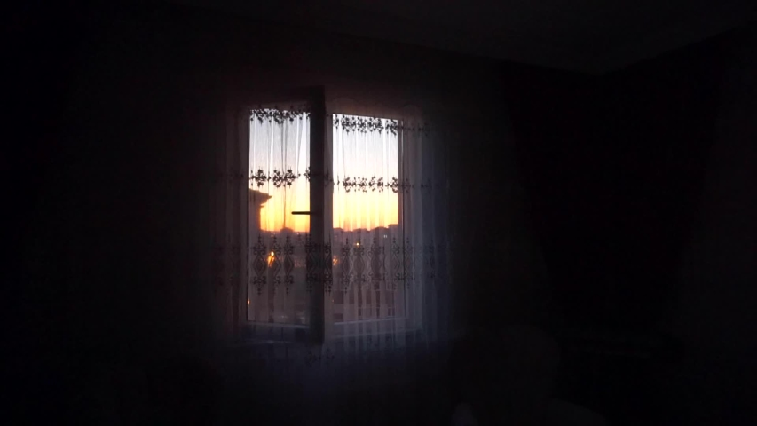 The morning sunrise from the window of a house at dawn | Shutterstock HD Video #1037103161