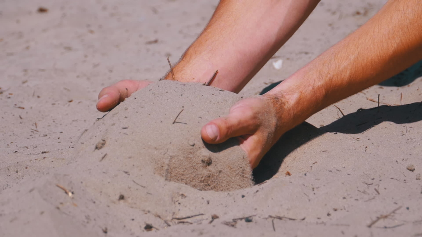 Male Hands Falling Sand on the Beach in Slow Motion 180 fps. Sand grains roll down from above. Dirty sand in the hands of men. Close-up view of grains running through a male finger. Sand Pour From | Shutterstock HD Video #1037115281