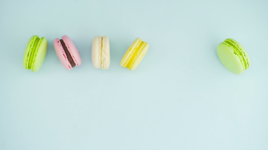 Color Macaroons or macaron on pastel blue surface | Shutterstock HD Video #1037172671