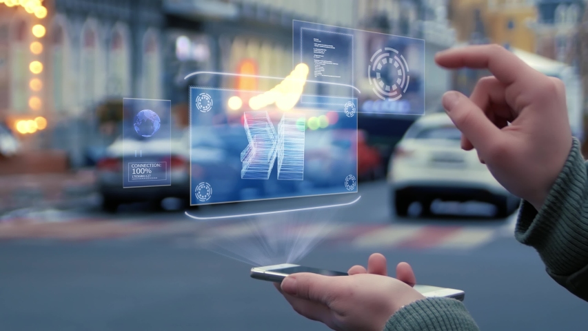 Female hands on the street interact with a HUD hologram with stacks of money. Woman uses the holographic technology of the future in the smartphone screen on the background of the evening city   Shutterstock HD Video #1037261741