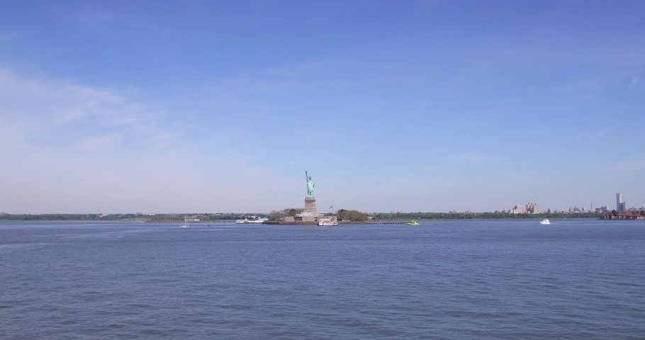 Wide shot of the Liberty Lady in the heart of the Port of New York and New Jersey. | Shutterstock HD Video #1037285291