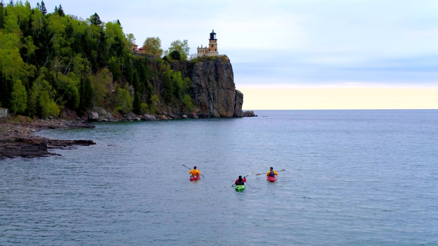 Three Kayakers at Split Rock Lighthouse, Minnesota, Aerial Drone | Shutterstock HD Video #1037304401