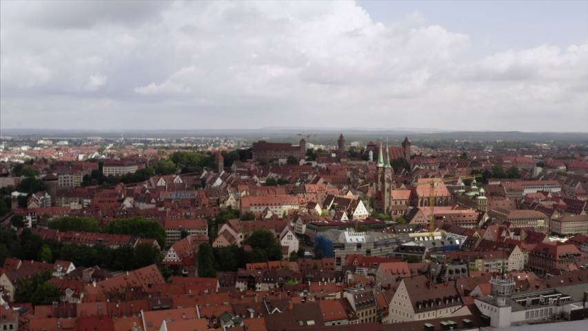 Wide view on the city Nuremberg (Nurnberg). The drone is flying over the architecture to the castle. | Shutterstock HD Video #1037309411