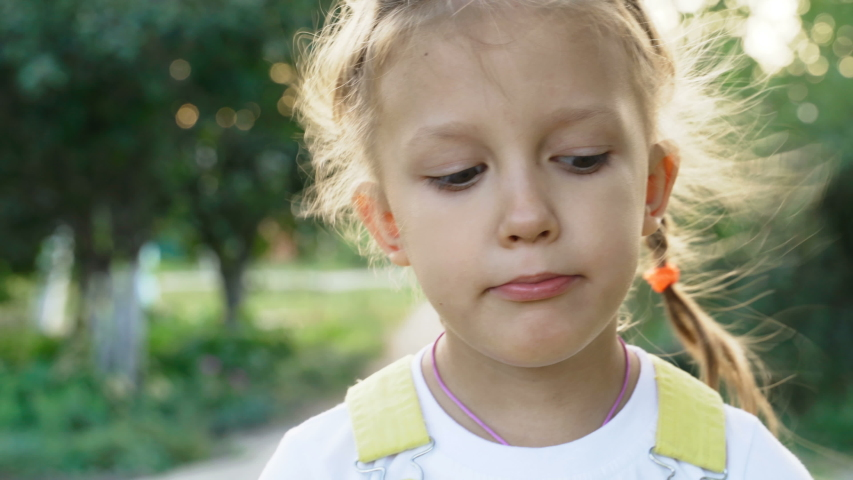Portrait Little Girl Child Expresses Emotion And Grimaces Shows   Shutterstock HD Video #1037314481