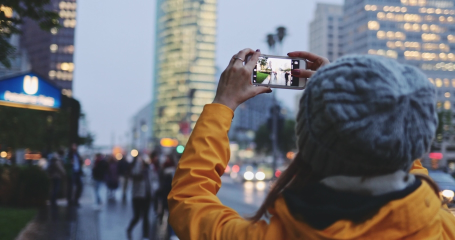 Young Woman Using Smartphone in the City, Taking Pictures. SLOW MOTION 4K. Girl using cell phone photography app, traffic lights background. | Shutterstock HD Video #1037334881