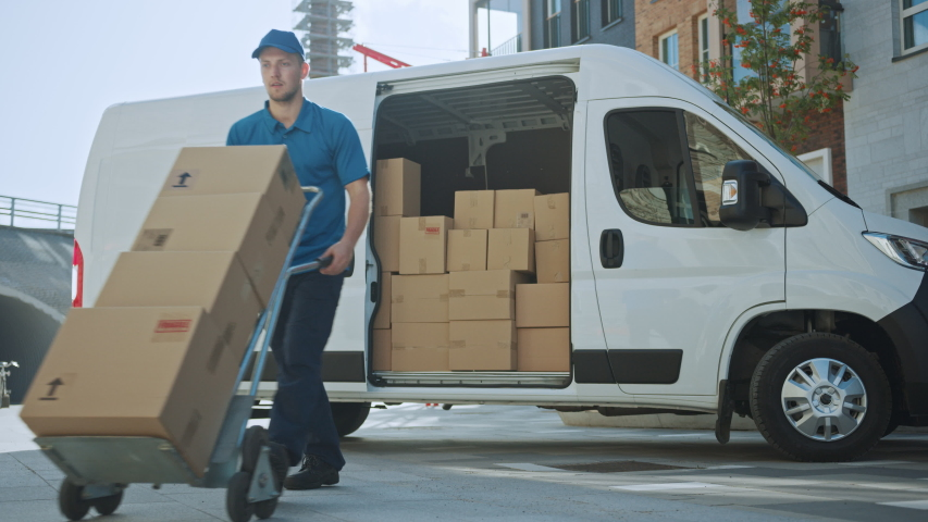 Courier Opens Delivery Van Side Door and Takes out Cardboard Box Package, Closes the Door and Goes on Delivering Postal Parcel. Shot on RED EPIC-W 8K | Shutterstock HD Video #1037351201