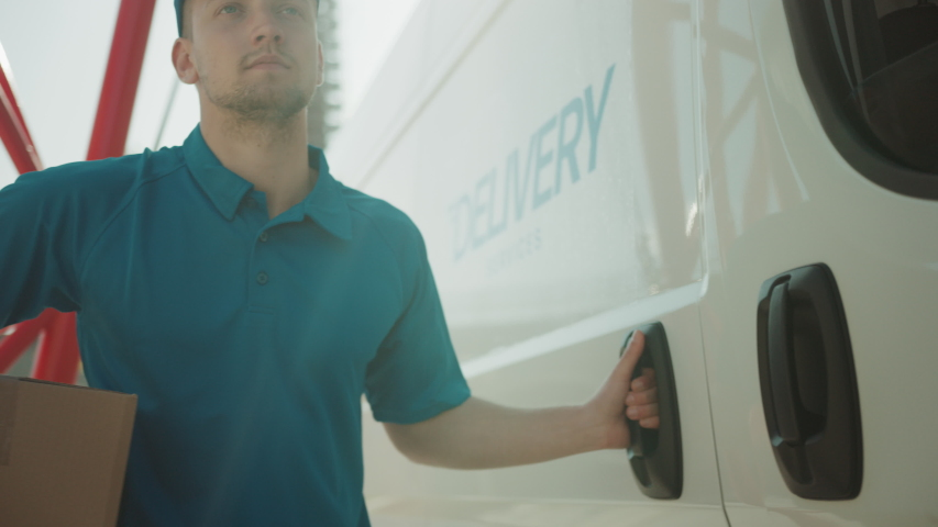 Courier Opens Delivery Van Side Door and Takes out Cardboard Box Package, Closes the Door and Goes on Delivering Postal Parcel. Slow Motion   Shutterstock HD Video #1037351351
