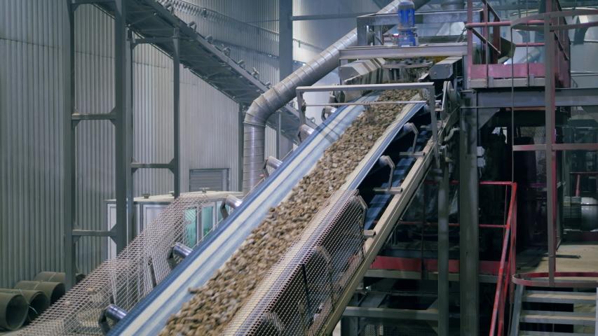 Factory conveyor line moving stones. | Shutterstock HD Video #1037519411