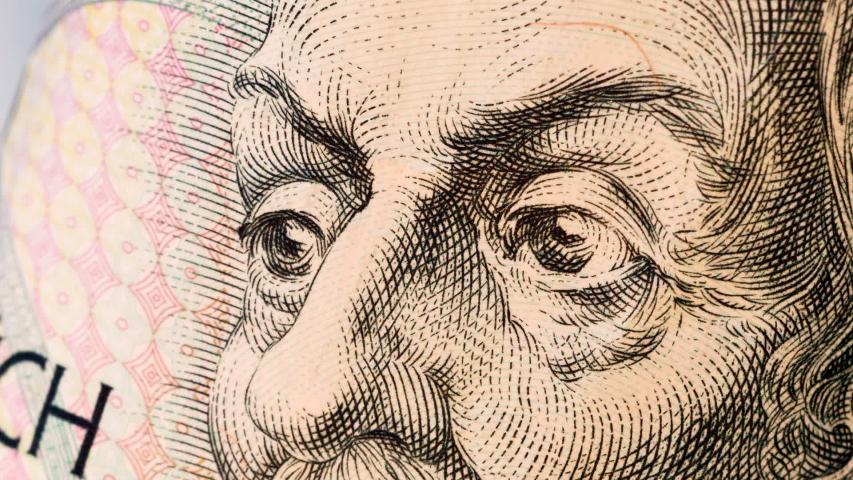 Eyes from portraits painted on money. Currency stop motion. World money detail.   Shutterstock HD Video #1037679701