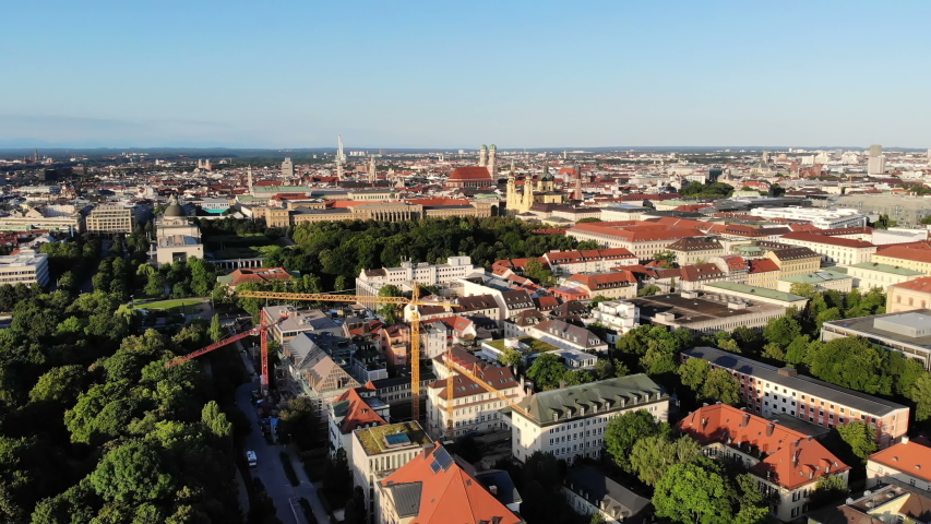 Drone video of Munich, Germany. Aerial view of city center and English garden. Sunny summer morning, clear blue sky. | Shutterstock HD Video #1037772011