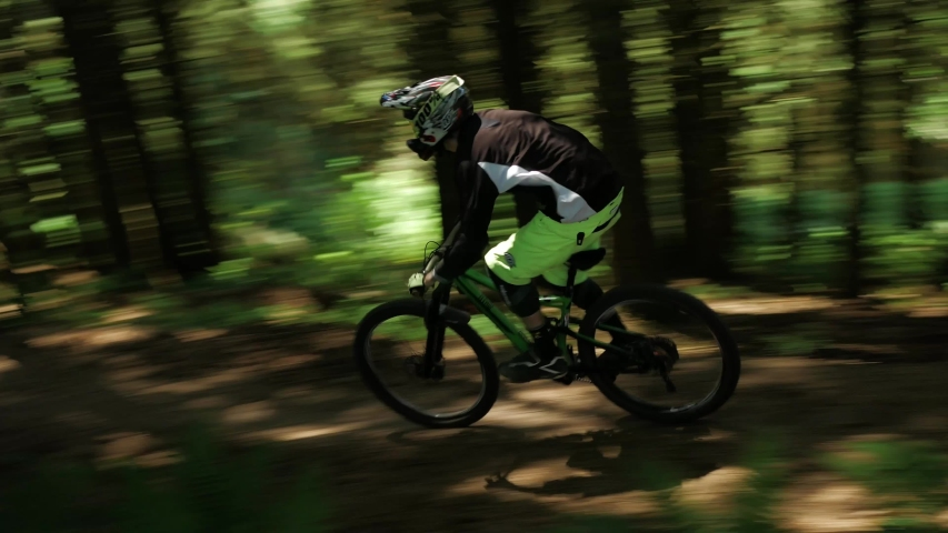 Barnstaple / United Kingdom (UK) - 05 20 2019: Mountain Biker Biking On Mtb with a lot of speed down the mountain in the forest.