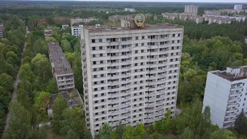 Huge destroyed building at the center of Pripyat city after Chernobyl nuclear tragedy | Shutterstock HD Video #1038009821