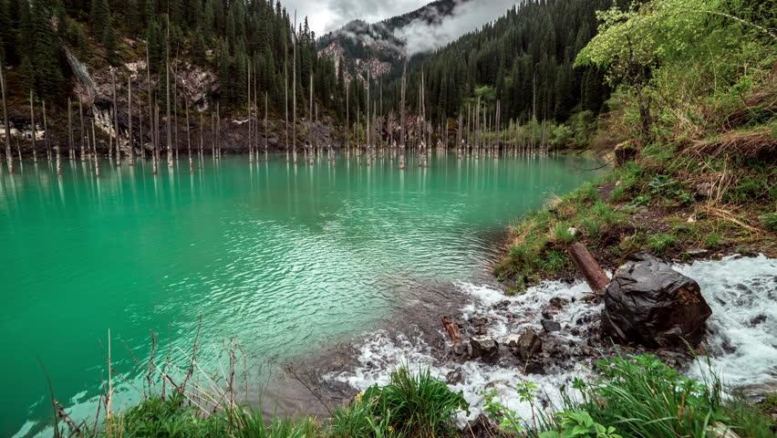 Almaty, Kazakhstan - 15 may 2015: mountain river in the lake Kaindy in Tyan-Shan mountains. 4K TimeLapse | Shutterstock HD Video #10384343