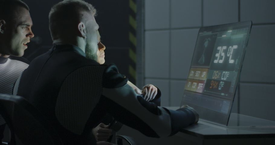 Medium shot of a female astronaut explaining data on living conditions of plant life displayed on a digital screen | Shutterstock HD Video #1038696431
