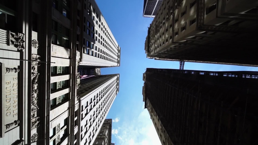 Moving looking up pov drone shot of NYC New York City Manhattan modern skyscraper high-rises. Concept of financial center, modern business city, historic iconic travel destination in USA. | Shutterstock HD Video #1038757181