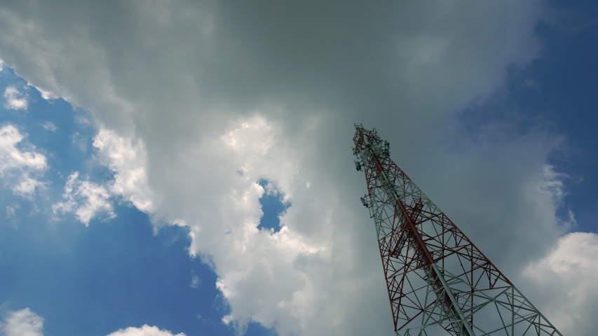 Time Lapse Signal tower or Mobile phone tower with dayligth sky and white cloud. Telecommunication tower Antenna.Modern communication concept by using 5 g internet   Shutterstock HD Video #1038887291