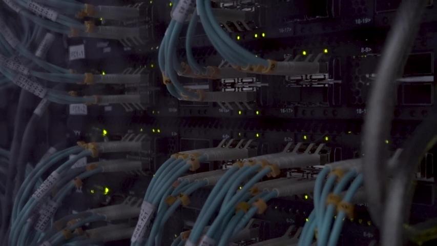 Server rack side view, working telecommunication server. Dark datacenter. | Shutterstock HD Video #1038905501