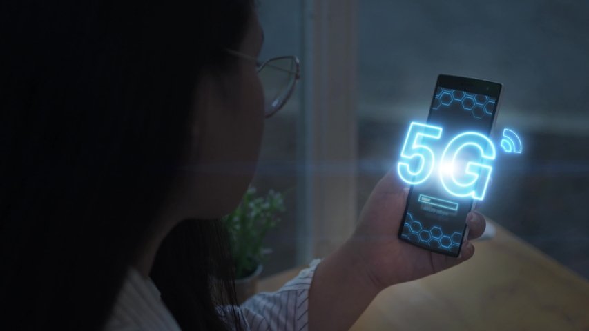 Asian girl holding smartphone using 5G mobile network .Wireless network, mobile technology concept | Shutterstock HD Video #1038925931