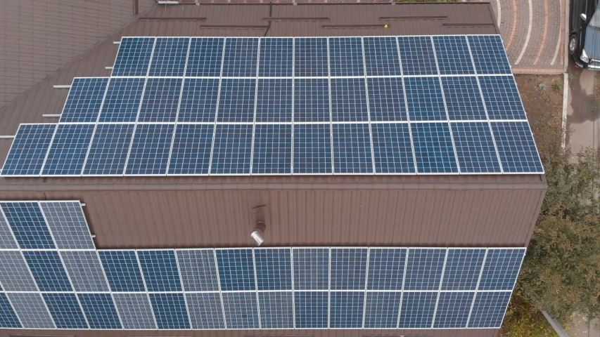 Declining Zoom Drone Shot Of The Panels Of Small Solar Power Plant