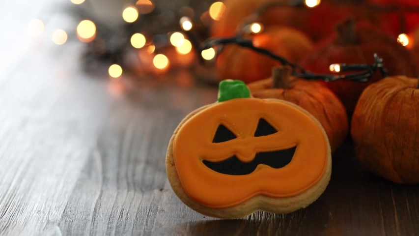 Halloween cookies with light on brown wooden background | Shutterstock HD Video #1039096031
