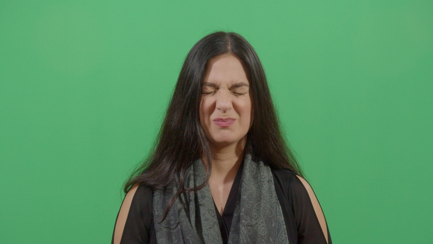 Woman Opening And Closing The Eyes. Studio Isolated Shot Against Green Screen Background | Shutterstock HD Video #1039150961