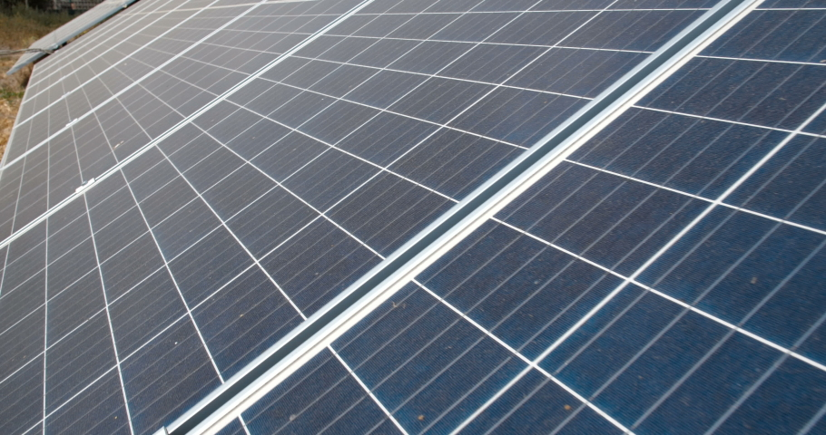 Extreme close up slide camera shot of the panels of small solar power plant mounted on the ground. Alternative energy sources. Ecological production of electricity without environment pollution   Shutterstock HD Video #1039181831