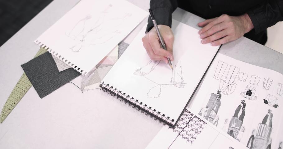 Overhead shot fashion designer sketching a design | Shutterstock HD Video #1039186001
