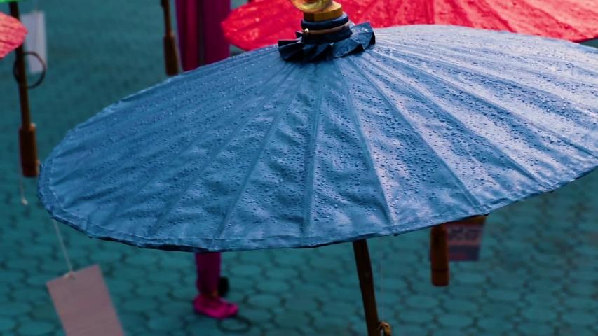 Umbrellas made of colorful fabrics, Thai crafts Lanna umbrella,Chiang Mai Thailand. | Shutterstock HD Video #1039281371