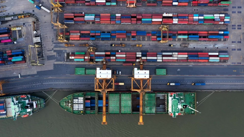 Aerial top view over international cargo ship at industrial import-export port prepare to load containers with big container loader ship vessel. Oversea international Business. | Shutterstock HD Video #1039446401