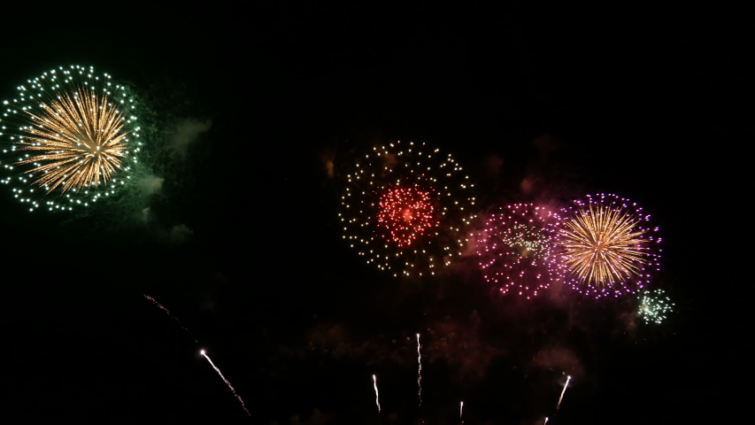 4K. long time seamless loop of real colorful fireworks festival in the sky display at night during national holiday, new year party or celebration event  | Shutterstock HD Video #1039570421
