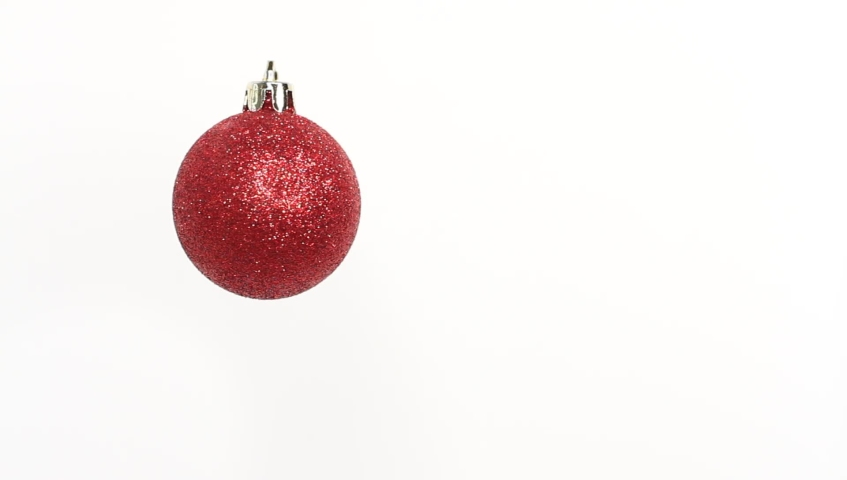Christmas and New Year red Ball. Rotating decoration on white background. Merry Christmas and a Happy New Year! | Shutterstock HD Video #1039591481