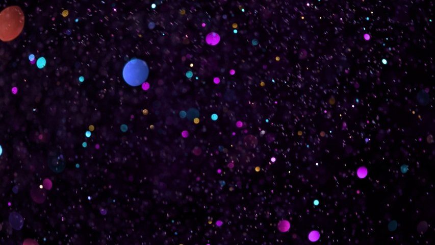 Colored Glitter Background in Super Slow Motion at 1000fps. | Shutterstock HD Video #1040100011