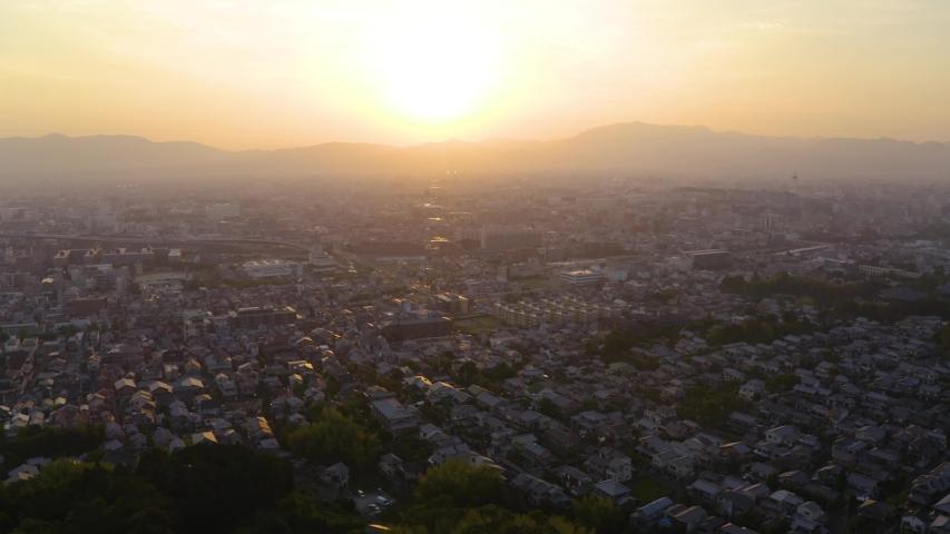 Kyoto sunset in japan revealing city, drone shot | Shutterstock HD Video #1040234711