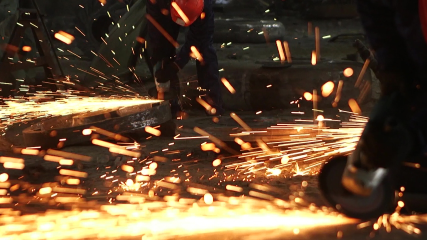 Sparks during cutting of metal angle grinder. A lot of glowing sparks flies around the rotating disk of the grinder. | Shutterstock HD Video #1040248571