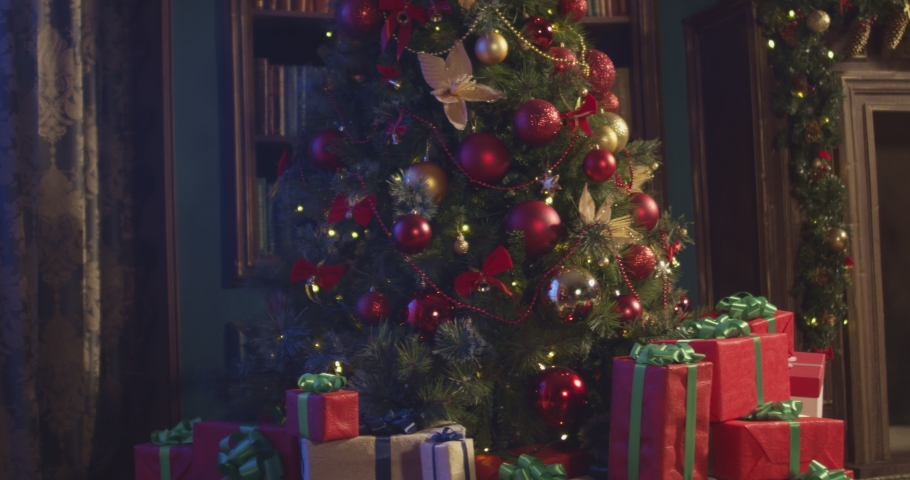 New Year 2020 mood, Christmas tree, happy holidays. Christmas gift box,   Christmas interior. Shot on Cinema Camera