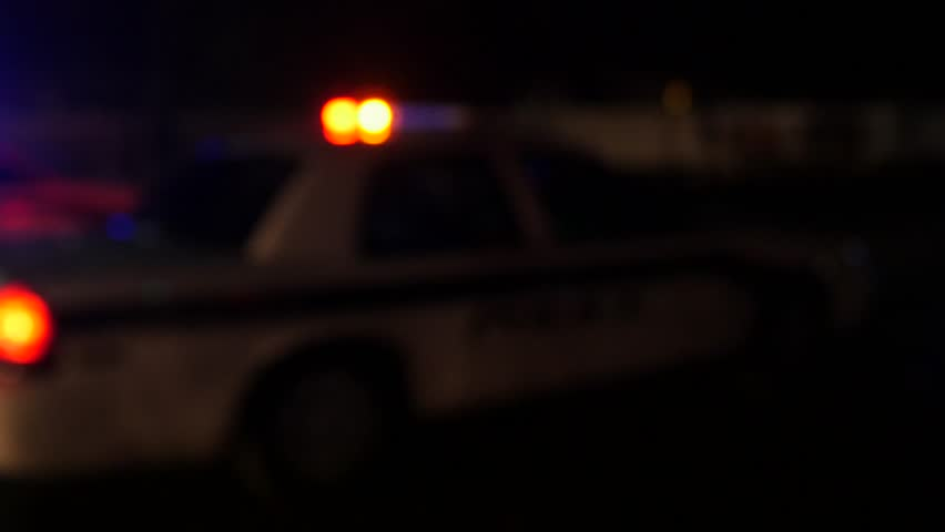 Police cars with their lights turned on at night at a scene of an accident | Shutterstock HD Video #10406441