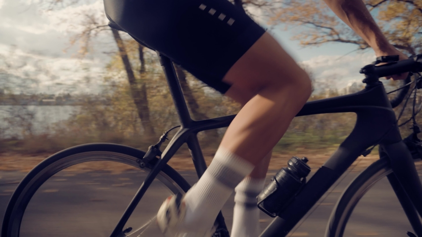 Cycling Athlete At Sunset Fall On City.Gear System Road Bicycle And Bike Wheel Rotation.Cyclist Twists Pedals And Riding On Road Bicycle.Close-Up Cyclist Pedaling On City Park At Autumn.Sport Concept | Shutterstock HD Video #1040661221