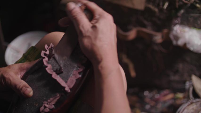 Senior shoemaker sitting in workshop making shoes with handmade. | Shutterstock HD Video #1040672261