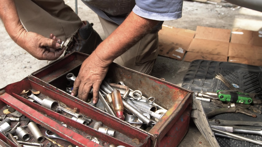 Mechanic hand in the toolbox | Shutterstock HD Video #1040684291