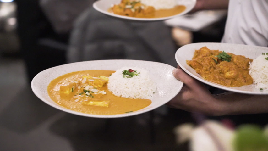 Butter Chicken and Rice served in a classy Indian restaurant | Shutterstock HD Video #1040912501